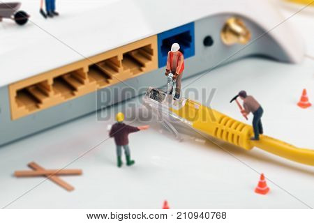 it support services. workers repairing internet connection