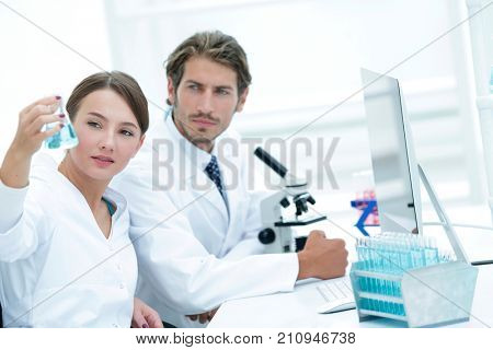 Team of Biologists Researchers Working in Laboratory