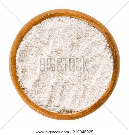 Whole wheat flour in wooden bowl. Whole-wheat flour, also wholemeal flour. White powdery substance and basic food ingredient, used in baking. Isolated macro food photo close up from above over white.