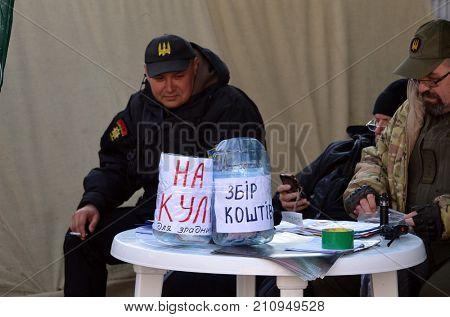 Kozlomaidan ver.3.0.New begging.Incription:Money for bullets for traitors(UKR).Rioters of Ukrainian Ragulution near Ukrainian Parliament protest against president .Kiev,Ukraine.October 25, 2017