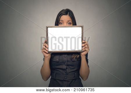 Grateful letter. Gratitude concept. Accolade. Thank letter. Special offer. Young business woman looks out from blank photo frame holding in her hands. Appreciation document.