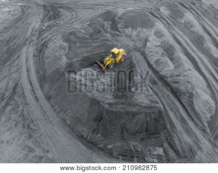 Open pit mine, breed sorting. Mining coal. Bulldozer sorts coal. Extractive industry, anthracite. Coal industry. Black gold