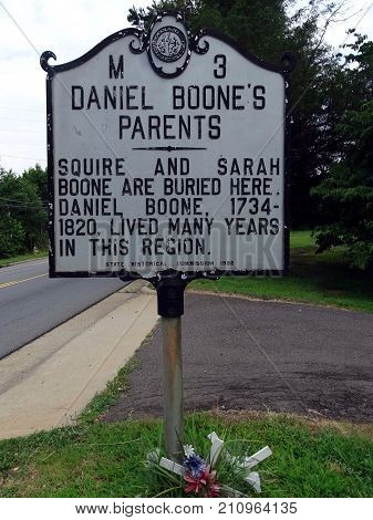 Mocksville, North Carolina-July 13, 2017:  A roadside sign indicating the location of Daniel Boone's Parents (Squire and Sarah Boone's) Grave in the adjacent cemetery  in North Carolina