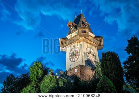 Graz, Austria - August 11, 2017: The Schlossberg at night. It is a tree-clad hill, and the site of a fortress, in the centre of the city of Graz, Austria.