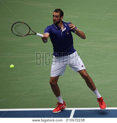 NEW YORK - AUGUST 28, 2017: Professional tennis player Marin Cilic of Croatia in action during his 2017 US Open first round match at Billie Jean King National Tennis Center