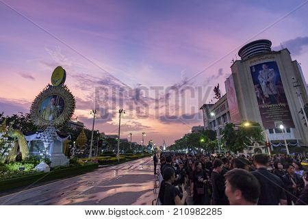BANGKOK THAILAND - OCTOBER 26: Unidentified people gather for the cremation of Rama IX at sunset on Ratchadamnoen Avenue in Bangkok Thailand on October 26 2017.