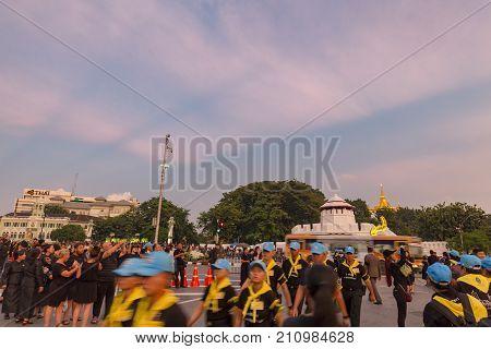 BANGKOK THAILAND - OCTOBER 26: Unidentified volunteers walk past Ratchadamnoen Avenue for the cremation of Rama 9 the former king in Bangkok Thailand on October 26 2017.