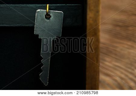 Organize Your Life, Insurance And Security Concept: A Key Hanging On Golden Hook In A Key Holder Box