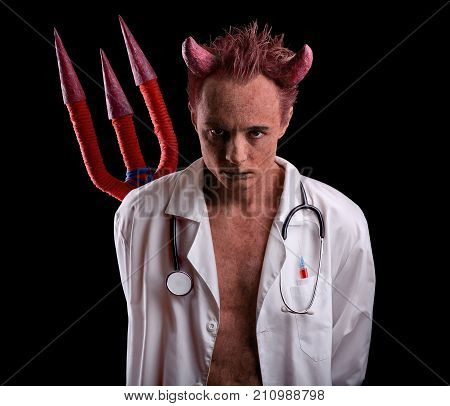 Doctor in the guise of a devil with a trident over his back. Deception in medicine.