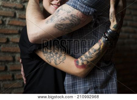 Tattoo Couple Embracing With Passion