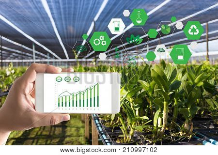 Agriculture Technology Concept Man Agronomist Using A Tablet Internet Of Things  Report