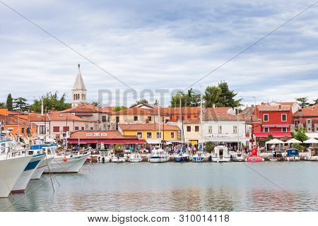 Novigrad, Istria, Croatia, Europe - September 3, 2017 - Boats And Houses Around The Harbor Of Novigr