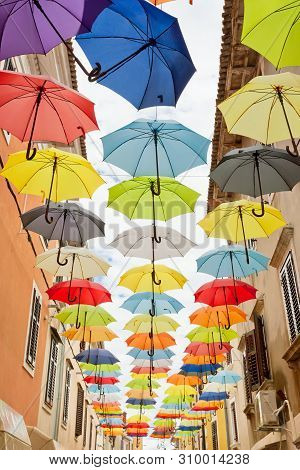 Novigrad, Istria, Croatia, Europe - Colorful Umbrellas Tied In Line To Celebrate Freedom