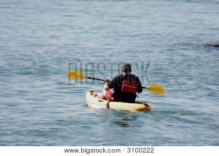 Male Kayaking On River