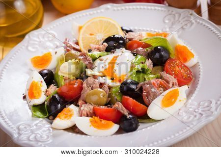 French Nicoise salad with eggs, tuna, olives  and vegetables
