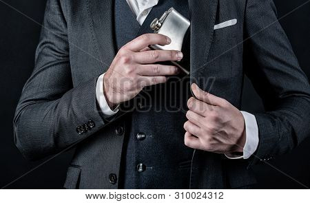 Male With Beard Put Whiskey Flask In Pocket. Man Has Bad Addiction. Businessman In Suit. Bachelor An