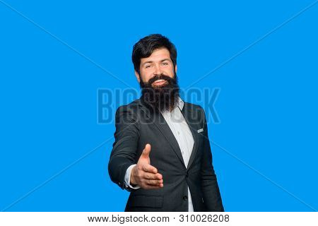 Friendly Businessman Is Welcome. Handshaking. Portrait Of Bearded Businessman. Businessman In Suit W