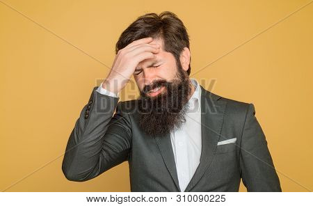 Bearded Man Suffering From Severe Headache. Helpless Face Expression. Stressed Businessman Has Stron