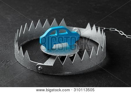 Trap With Bait Car. The Risk Of Buying Bad Car. Car Insurance. Black Background