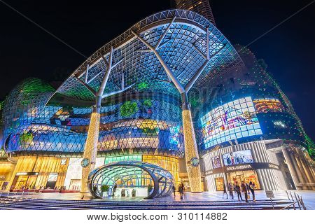 Orchard Road, Singapore - January 6, 2019 : Singapore Night City Skyline At Ion Orchard Shopping Mal