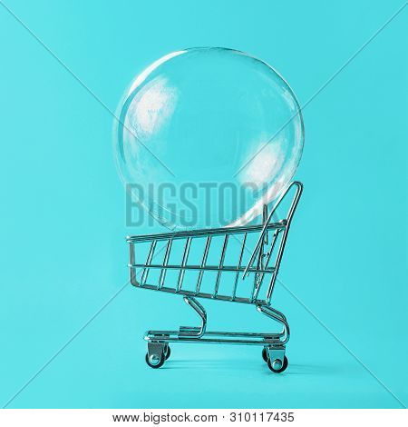 Shopping Cart With Soap Bubble On Bright Blue Background. Ephemeral Happiness From Shopping, Shopaho
