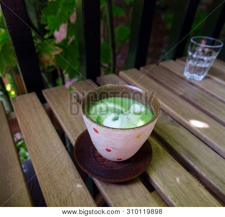 Matcha Tea In Ceramic Cup With Ornament In Teahouse In Victoria, British Columbia