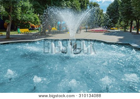 Waterworks Fountain With Water Sprays And Geysers In Park Or Garden. Summer Day Time Freshness And R