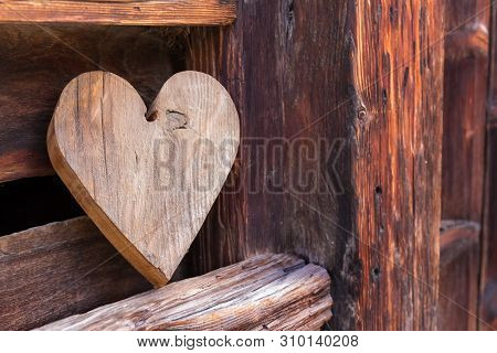 Wooden Heart Outside Of A Rustical Barn As A Sign For Welcome