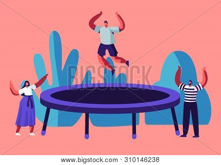 Happy Man Jumping On Trampoline, Friends Cheering. Young People Having Fun Jump And Bouncing, Spare