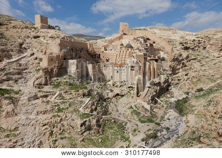 Holy Lavra of Saint Sabbas the Sanctified, known in Arabic as Mar Saba monastery perched on the rocks in the Judean desert in Israel. West Bank, Palestine, Israel. Remote monastery poster