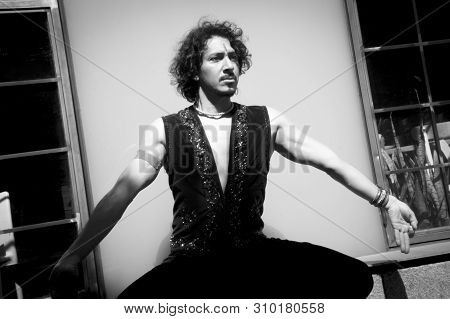 Bollywood Dancer Man Over Urban Background. Black And White