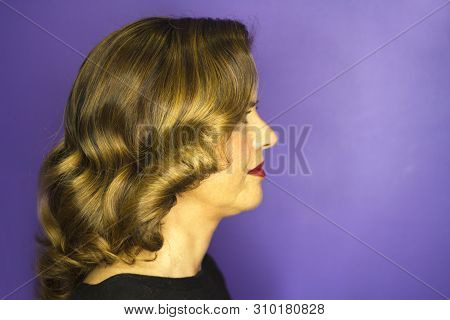 Middleaged Woman With Wavy Brown Hair. Red Lips