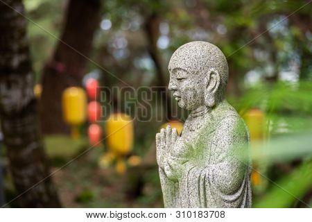 stone statue of Earth Store Bodhisattva(k?itigarbha bodhisattva) in a garden