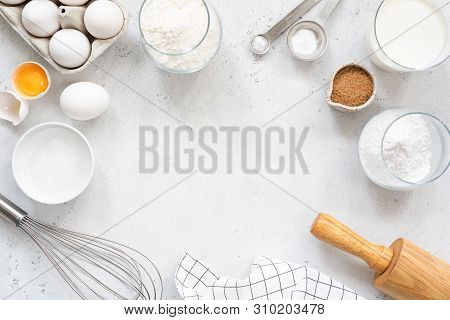 Frame Of Baking And Cooking Bread Pastry Or Cake Ingredients, Flour Sugar Milk Eggs And Coconut Butt