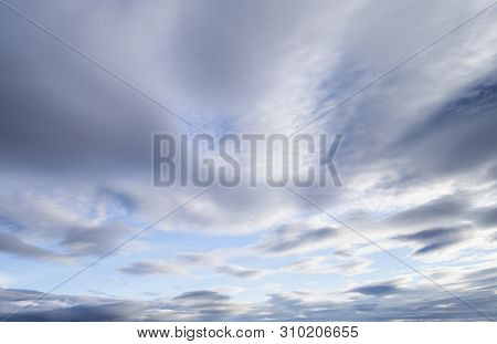 The Image Shows A Blue Sky With Tiny Clouds