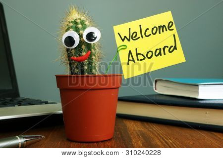 Welcome Aboard Concept. Funny Cactus On Workplace In The Office.