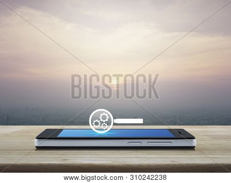 Seo Flat Icon On Modern Smart Mobile Phone Screen On Wooden Table Over City Tower And Skyscraper At