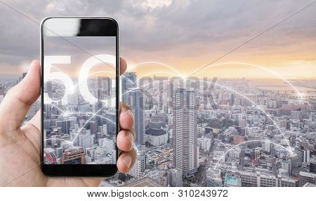 Hand Using Mobile Smart Phone, And Wireless Network Connection Technology In The City, With 5g Inter