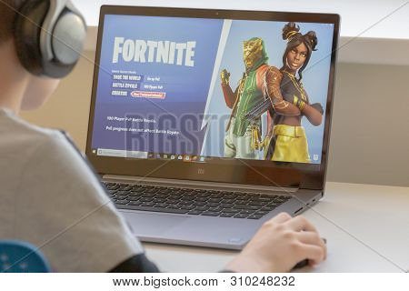 Vilnius, Lithuania - July 2, 2019: Boy Playing Fortnite Game. Fortnite Is Online Video Game Develope