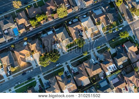 Aerial view of residential rooftops, streets and alleys in Los Angeles County California.