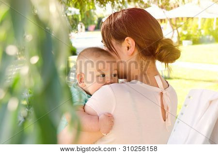 A Mother And Baby On Vocations Outdoors