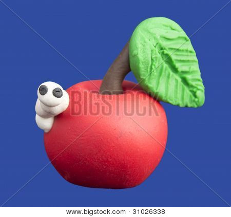 White worm and a red apple