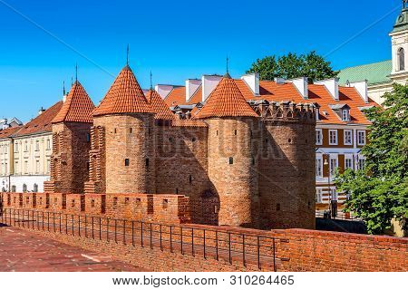 Warsaw, Poland Barbican Or Barbakan- Semicircular Fortified Xvi Century Outpost With The Defense Wal