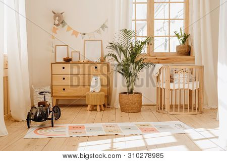 Chalet Baby Bedroom Interior With Cozy Cradle Bed. Light Brown Childish Room With Wooden Empty Cot.