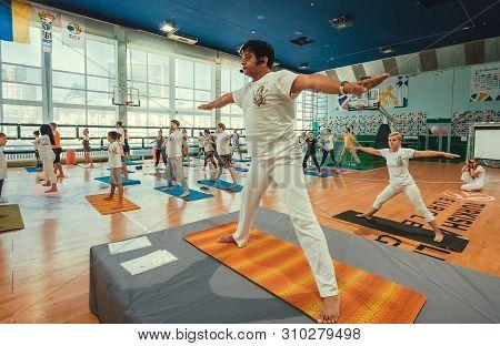 Kyiv, Ukraine: Yoga Teacher Showing Asana For Active People In Sport Studio, Training Class On 15 Ju