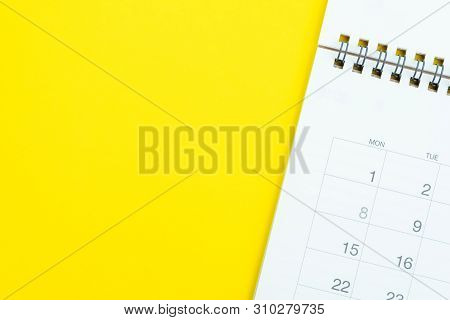 Flat Lay Of White Clean Desktop Calendar On Solid Yellow Background Using As Reminder, Memo, Meeting