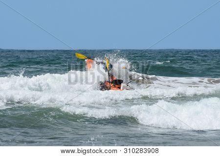 Ocean Kayak Crashing Through The Waves, Mossel Bay, South Africa