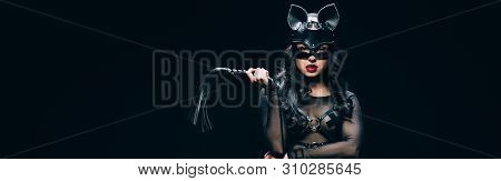 Panoramic Shot Of Sexy Young Brunette Woman In Bdsm Costume And Mask With Leather Flogging Whip Isol