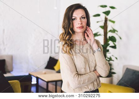 Good Looking Mid Aged Woman Portrait At Home. Elegant Business Woman. Middle-aged Woman Standing In