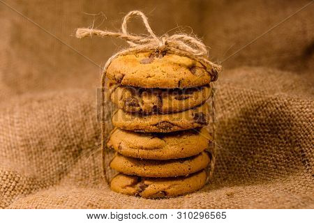 Stack Of Chocolate Chip Cookies On Sackcloth